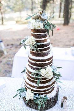 Unique naked wedding cake idea - naked chocolate wedding cake with white frosting + ivory roses and eucalyptus + bird figurine cake topper {Jacquelynn Brynn Photography} #chocolateweddingcakes #weddingcakes