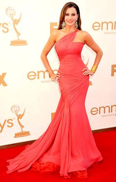 Sofia Vergara showed off her sexy shape in a Vera Wang gown at the 2011 Emmys. She accessorized with Lorraine Schwartz emerald earrings, a gold cuff and an emerald pinky ring.