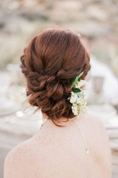 This braided chignon is a lovely balance of classic and romantic. The perfect updo for an outdoor wedding.   Photo by: Whiskers and Willow Photography