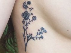 Small flower side/rib tattoo