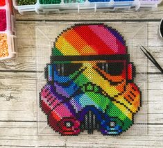 Getting this one in juuuuust under the wire for Pride Month. Hope you all like the shading on Pride Trooper, it was a pain to do! Though I am IN LOVE with how vibrant and colorful this guy came out!! .........#perlerart #perlerartist #pixelart #pixelartist #perlerbeads #perlerbrand #starwars #stormtrooper #pride #pridemonth #pride #rainbow #lgbt #prideparade #gay #lesbian #spaceisgay