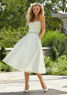Pocket Summer rhinestone belts tea length sweetheart neckline wedding dress $88.00 With a lace shrug it could be perfect.