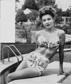 This is a model wearing a swimsuit from the 1940's, in comparison to today's bikini's I wouldn't say there is too much of a difference in look. Except for the fact maybe the fabric difference and that for today's bikini's theres probably a choice of thicker padding and more revealing. I'm actually surprised how similar the bikini top is in comparison to todays bikini look, and I think actually the high waisted bottoms look is actually making a come back in many fashion brands. 3/28/16