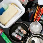 Build A Mobile Kitchen: Make things easy by packing essentials in a box just for trips, includes a checklist to download.