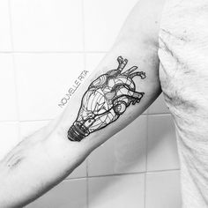 #nouvellerita #lightbulb #heart #tattoo #linework #blackworkers #tattrx