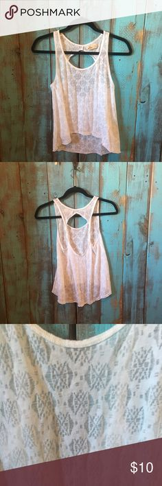 Hollister tank top size extra small Excellent used condition Hollister open back tank top size extra small. Daughter wore it once over bikini top in Hawaii and never wore again. Washed in cold and hung dried. No stains, rips or tears. 54% cotton, 64% polyester. No trades! Hollister Tops Tank Tops