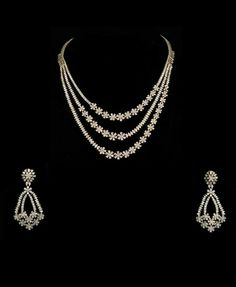An art-deco style necklace in diamonds- Art Deco jewellery focuses on linear designs made symmetrically- while the diamond shapes used (pears and marquise) are rather asymmetrical, their linear setting is eye-catching. Gold Jewellery Design, Gold Jewelry, Women Jewelry, Diamond Jewellery, Diamond Bangle, Diamond Pendant, Jewelry Model, Necklace Designs, Wedding Jewelry