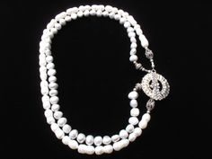 Double stranded freshwater pearl necklace with sterling silver sunflower toggle... inspiration