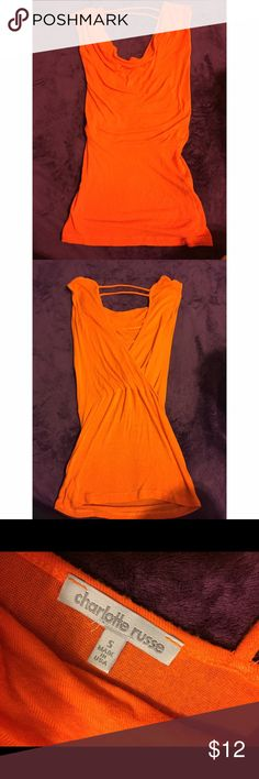 Orange cowl neck shirt Cowl neck shirt. Open back. Lightly worn and in good condition. Charlotte Russe Tops Blouses