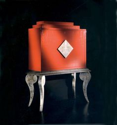 COCKTAIL CABINET ART 8031 - LARGE IMAGE OF RED LACQUERED COCKTAIL CABINET ON AN ANTIQUED SILVER STAND