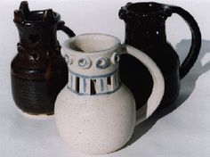 MOONSTONE POTTERY: LEWIS CHESS SET, PUZZLE MUG, POTTERY LAMP, COSTREL, PILGRIM BOTTLE, PITCHER AND GOBLETS.