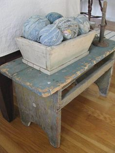 Antique bench, old wooden box, and some wonderful rag balls