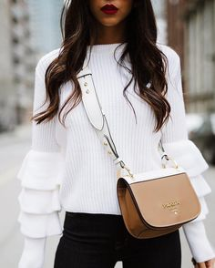 A cozy sweater with added flounce is the perfect way to be feel comfy but look chic during the holidays. Don't forget to inject fun accessories to top off your look.