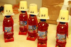 Agency D3 VBS snack idea from the VBS at Riverton FBC. Robots with pudding cup heads, Hawaiian Punch bodies, and raisin snack box feet. Attach pieces w/ craft store glue dots.