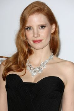 Jessica Chastain's make-up look comprised shimmery pastel eyeshadow, extra-long lashes, flushed cheeks and sheer pink lipstick, complemented by loosely-curled hair.