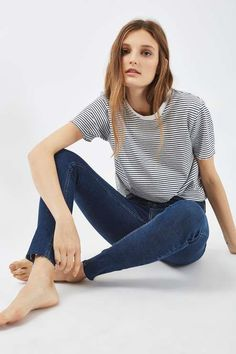 In a perennially cool high-waisted fit, the MOTO Jamie is the original rock n' roll skinny jeans that we fell in love with all those years ago. Crafted in a super-stretchy cotton blend for our signature soft denim feel, the iconic style includes multiple pockets, a top button fly and raw hem detail for an edgy finish. #Topshop