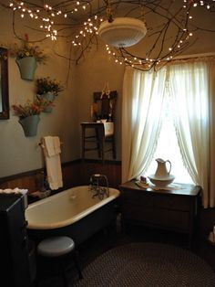 bathroom ~ but look at the branches and twinkle lights on the ceiling. Just what Ariana was describing to me.