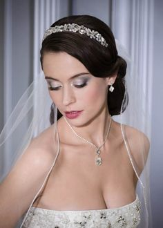 Oh this is SO me. The romantic sweep of the hair, the sparkle in the headband, and a comb-piece veil. Amazing.
