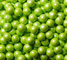A bright spot in your candy drawer, these Shimmer Lime Green Sixlets are pretty hard to miss! These little gems combine the great taste of chocolate all wrapped up in a glossy lime green shell. As decorative as they are delicious, there are so many uses for these guys. And that's a pretty good thing, because these come with approximately 400 pieces per pound!