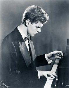 """Harvey Lavan """"Van"""" Cliburn, Jr., (1934–2013) American pianist who achieved worldwide recognition in 1958 at the age of 23, when he won the first quadrennial International Tchaikovsky Piano Competition in Moscow at the height of the Cold War. In 1998, Cliburn was named in a lawsuit by his domestic partner of 17 years, Thomas Zaremba. In the suit, Zaremba claimed entitlement to a portion of Cliburn's income & assets & went on to charge that he might have been exposed to HIV"""