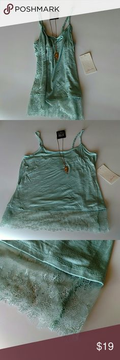 Frenchi tank From Nordstrom's. Adorable soft tank with lace bottom. Function and fringe necklaces not included but is for sale in my closet as well. Frenchi Tops Tank Tops