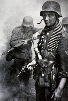 German grenadiers in action, undated. Note the Luger 9mm pistol. From the posture of the men they seem to be trying to round a corner -- and getting ready for the unexpected.