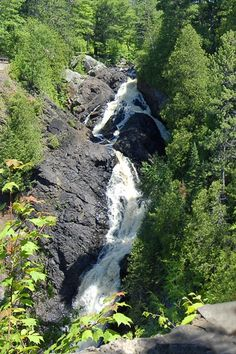 Climb up high to gaze at Northwest Wisconsin's highest waterfall. Located in Superior, Wisconsin at Pattison State Park, Big Manitou Falls' impressive 165 foot drop into the Black River is a stunning natural attraction!