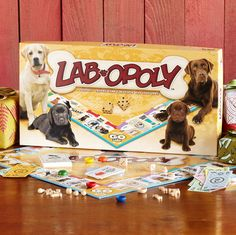 Pet game for people, celebrating the wonderful world of dogs in an earth-friendly way with recycled and recyclable materials. Using clever wood tokens, players buy dogs, collect dog houses and trade for big bones. Made in the USA.