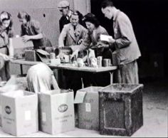 Redistributing the food received from the Allies.