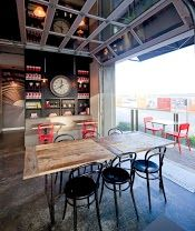Rustic communal table in the Brewery District Take Five Cafe