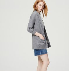 In an elegant longer length, we love the effortless wearability of this pocketed cardi. Long sleeves. Drop shoulders. Reverse jersey trim at placket. Front pockets. Ribbed cuffs and hem.