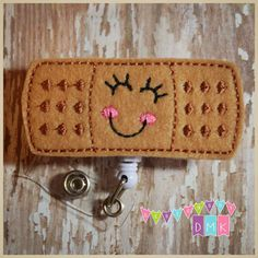 Items similar to Betty the Bandage - Felt Badge Reel - Retractable ID Badge Holder - Embroidered - Name Tag - Alligator or Slide Clip on Etsy Id Badge Holders, Badge Reel, Doctor Costume, Retractable Id Badge Holder, Puppy Face, Band Aid, Coin Purse, Great Gifts, Felt