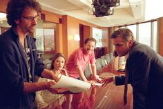"The Coen Brothers (Joel, left / Ethan, center) talk with Catherine Zeta-Jones and George Clooney on the set of ""Intolerable Cruelty"", 2003."