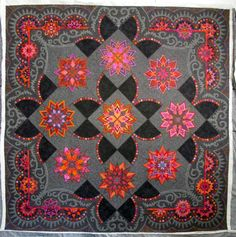 Stars on Mars from The Secret Life of Mrs. Meatloaf website-this was entered into Road to California 2014 by Gail Stepanek and Jan Hutchinson and won a ribbon for outstanding innovative quilt