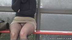 Public pantyhose upskirt video woman at bus stop in fishnet tights and mini skirt.