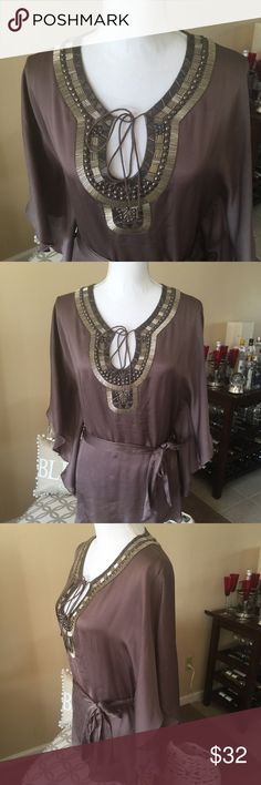 🔥HOTT Silk Embroidered Bebe Top Beautiful soft, silky bebe top. Beautifully embroidered along the neck and bust. Excellent condition with no missing embroidery. Size medium. 100% silk. It's a mocha color. bebe Tops