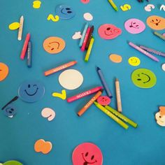 Simple large piece of paper across dining table crayons and stickers xxx