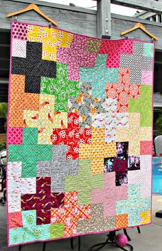 """Rainbow Plus Quilt by Darci - Stitches, 6"""" (finished) squares, five of each print, 66 x 78."""