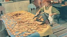 An old Norwegian photograph: An ambitious cookie maker !!! Look at all the different cookies she's making. It looks like gingerbread dough.