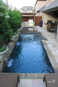 geometric pool with stacked stone edging
