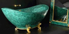 malachite bathtub with 22k gold feet