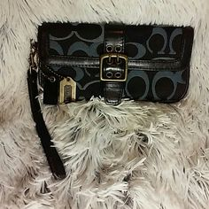 Coach signature wristlet in unused condition. Coach wristlet that shows no signs of use inside or out. Coach Bags Clutches & Wristlets