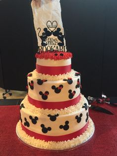 Wedding cake I made for a Mickey & Minnie Mouse wedding theme. I had to hold up a paper towel behind the topper to take the picture because the background was the same color.