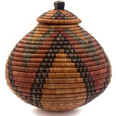 Approximately 9  Tall x 8.75  Across  To create this traditional basket, weavers use strips of naturally waxy palm fronds wrapped around coils of wild grasses. Some baskets are still used for liquid storage in the rural areas of South Africa. Watertight baskets are readied by rubbing wet cornmeal inside. When liquid is added, the coils swell. Some leaks through, evaporates, and cools the contents.  Designs carry cultural significance and many large baskets are traditionally given at…