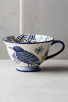 Anthropologie's collection of mugs and teacups are perfect for starting a relaxing morning with a cup of tea. Browse our unique mugs today. Ceramic Cups, Glazed Ceramic, Ceramic Pottery, Ceramic Art, Pebeo Porcelaine, Mythical Birds, Blue And White China, Dark Blue, Dinnerware Sets