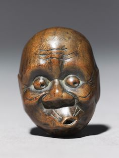 Netsuke in the form of a hyottoko mask.,  Japan, 18th century (1701 - 1800)