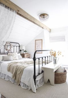 A Beautiful Farmhouse Bedroom Decorated With Simple Touches Of Fall Neutral Bedding