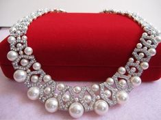 This elegant and eye catching necklace has gorgeous Swarovski cream pearls and Rhinestone spacers.