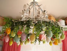 I want to do this over the dinner table. when we have easter dinner there is never enough room for the food and the centerpeice. This would be so fun and cute.