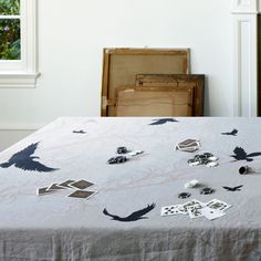 Huddleson Linens - Crow Linen Napkins - Contemporary Napkin ---- ~Ok, I have a weird thing for crows but, even if I didn't, this is still a beautiful tablecloth. I would be very tempted to use it as a wall hanging.
